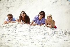 Friends on sand Stock Image
