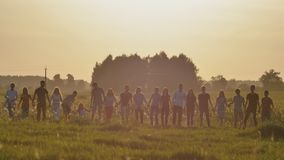 Friends of schoolchildren are bouncing at sunset in the sun. Friends of schoolchildren are bouncing at sunset in the sun stock video