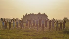 Friends of schoolchildren are bouncing at sunset in the sun. stock images