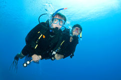 Friends scuba dive togeather royalty free stock images
