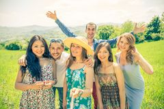 Friends with selfie stick on the beach Royalty Free Stock Image