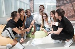 Friends shaking hands when discussing a new project.?. Friends shaking hands when discussing a new project. the concept of a startup royalty free stock photography