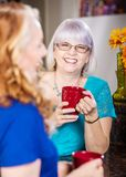 Friends Share a Laugh drinking coffee stock photo