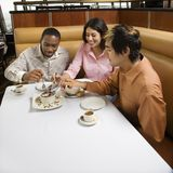 Friends sharing dessert. Royalty Free Stock Image
