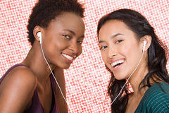 Friends sharing mp3 player Royalty Free Stock Photo