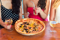 Friends sharing a pizza Stock Image