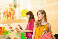 Friends shoe shopping in a mall. Or shop having fun Royalty Free Stock Images