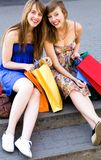 Friends with shopping bags. Happy young women with shopping bags royalty free stock images