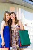 Friends with shopping bags Stock Images