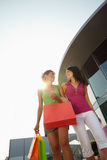 Friends with shopping bags Royalty Free Stock Image