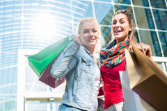 Friends shopping with bags in city Royalty Free Stock Photos