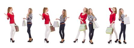 The friends with shopping bags isolated on white. Friends with shopping bags isolated on white Stock Photos