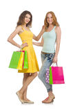 Friends with shopping bags isolated Royalty Free Stock Photos