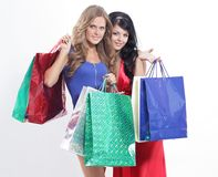 Friends with shopping bags isolated on white Stock Photos