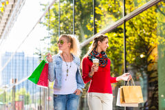Friends with shopping bags in street Royalty Free Stock Image
