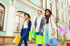 Friends with shopping bags during travel in Europe Royalty Free Stock Images
