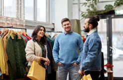 Friends shopping bags at vintage clothing store Stock Photography