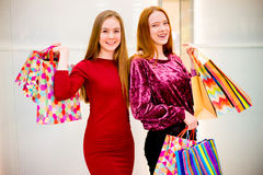 Friends shopping in mall Stock Images