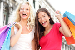 Friends shopping women excited and happy. Screaming joyful in Venice, Italy. Two girlfriends holding shopping bags having fun laughing. Beautiful Asian and Royalty Free Stock Photography