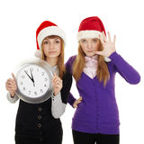 Friends show how little time left until new year. The two friends show how little time is left until the new year royalty free stock photography
