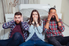 Friends showing that they did not hear, speak and see Stock Photos
