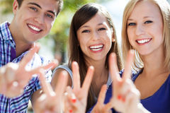 Friends showing peace sign Stock Image