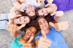 Friends showing thumbs up Royalty Free Stock Photos