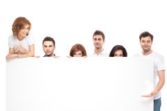 Friends showing white board Royalty Free Stock Image