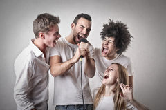 Friends singing Royalty Free Stock Images