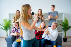 Friends singing a song together Stock Images