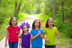 Friends and sister girls walking outdoor in forest track Royalty Free Stock Photos
