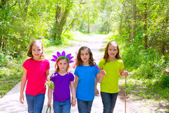 Friends and sister girls walking outdoor in forest track Stock Photos