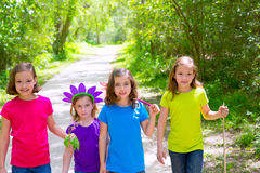 Friends and sister girls walking outdoor in forest track Royalty Free Stock Image