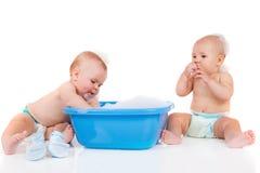 Friends sit beside tub stock image