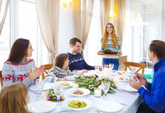 Friends Sitting Around A Table And Enjoying Christmas Dinner Tog Stock Image