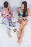 Friends sitting with coffee in bed Royalty Free Stock Photo