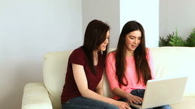 Friends sitting on couch stock footage