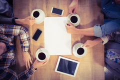 Friends sitting and drinking coffee Royalty Free Stock Photo