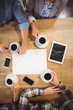 Friends sitting and drinking coffee Stock Photo