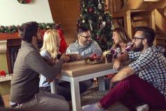 Friends enjoying Christmas morning coffee stock photo