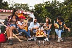 Free Friends Sitting Near Bonfire. Camping Season Royalty Free Stock Photography - 194694247