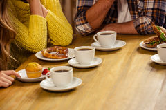 Friends sitting at a table Royalty Free Stock Images