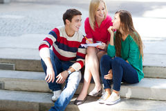 Friends sitting together Stock Photos