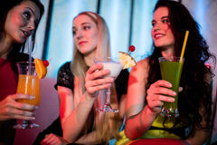 Friends sitting together and having mocktail. At bar Royalty Free Stock Photos