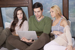 Friends sitting together on the sofa Royalty Free Stock Image
