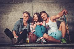 Friends with with skateboard outdoors Royalty Free Stock Photo
