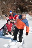 Friends sliding. And having fun in winter Royalty Free Stock Photography