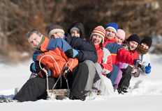 Friends sliding. And having fun in winter Stock Photography