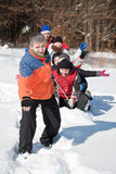 Friends sliding. And having fun in winter Royalty Free Stock Images