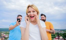 Friends and smartphone. Portrait of busy people talking on the m stock photography